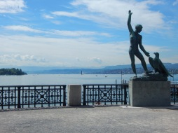Statue of man and bird by lake zurich (ganymed)