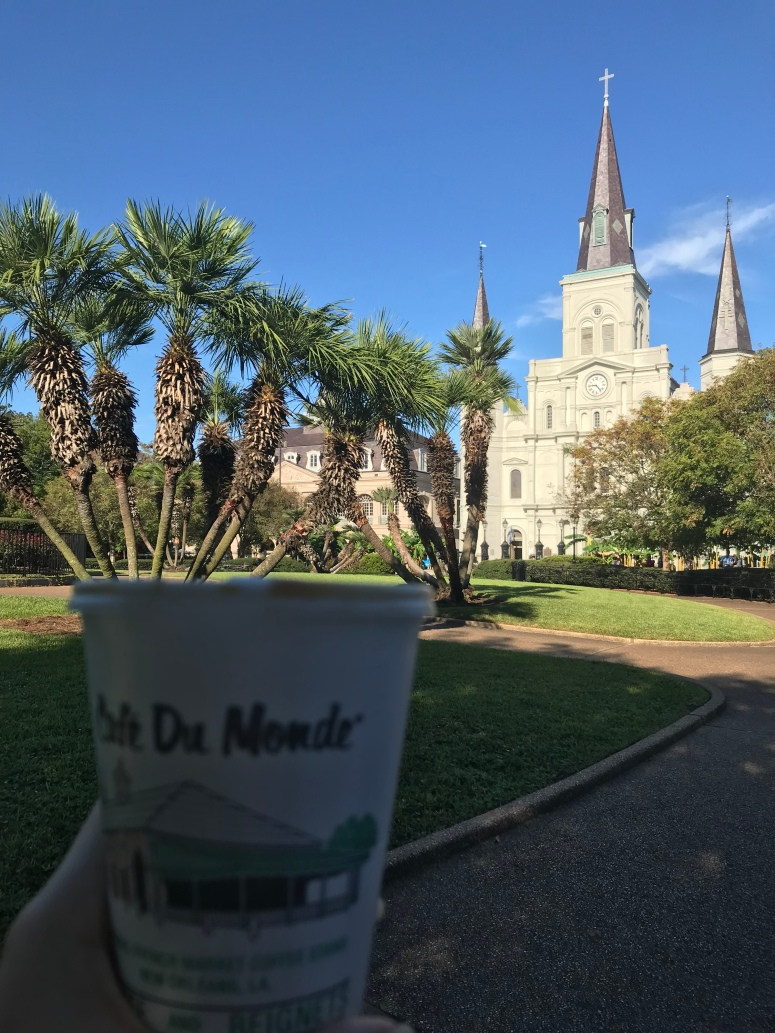 Drinking Cafe Du Monde in Jackson Square